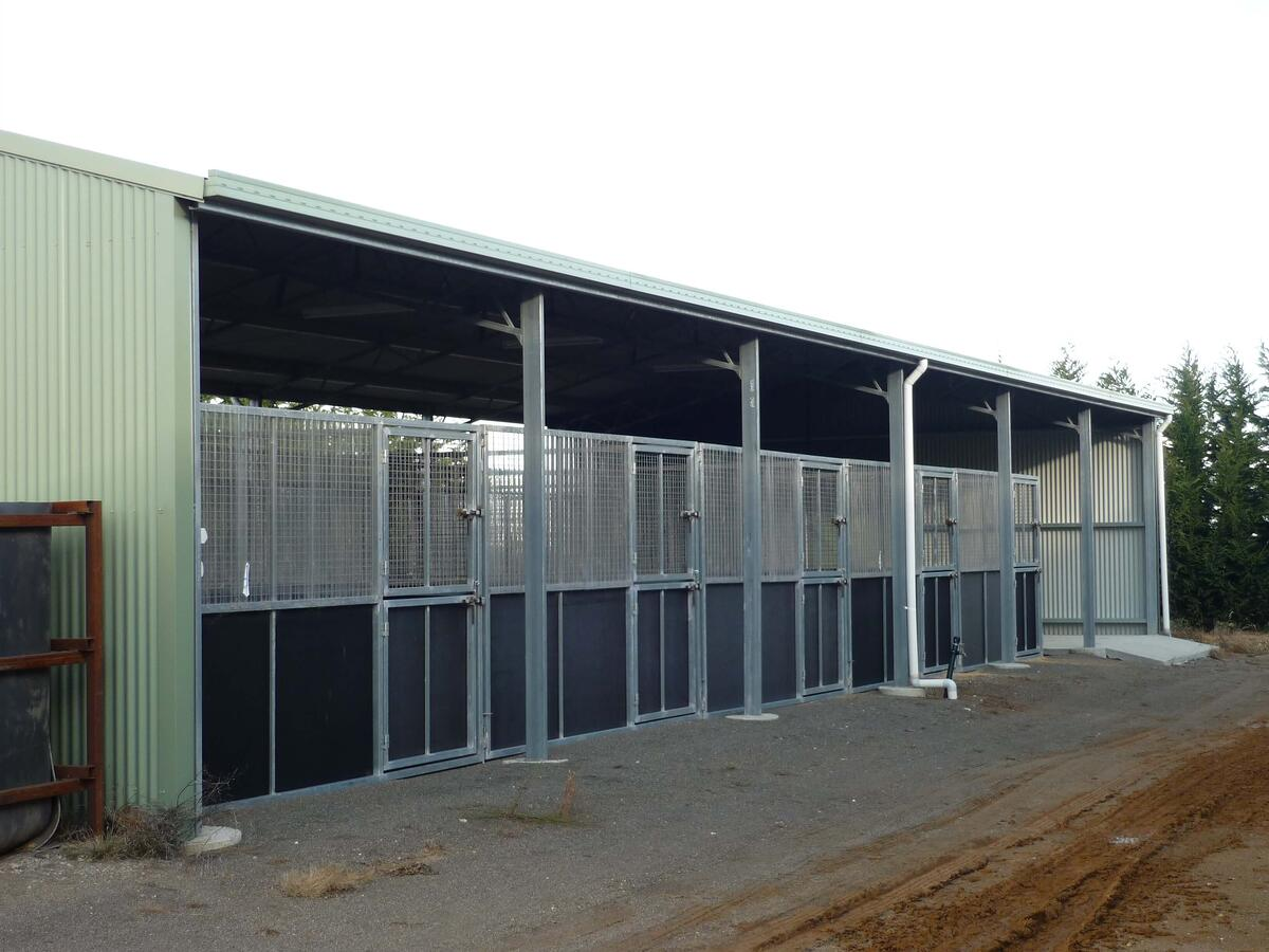 Horse stables with external lockable doors