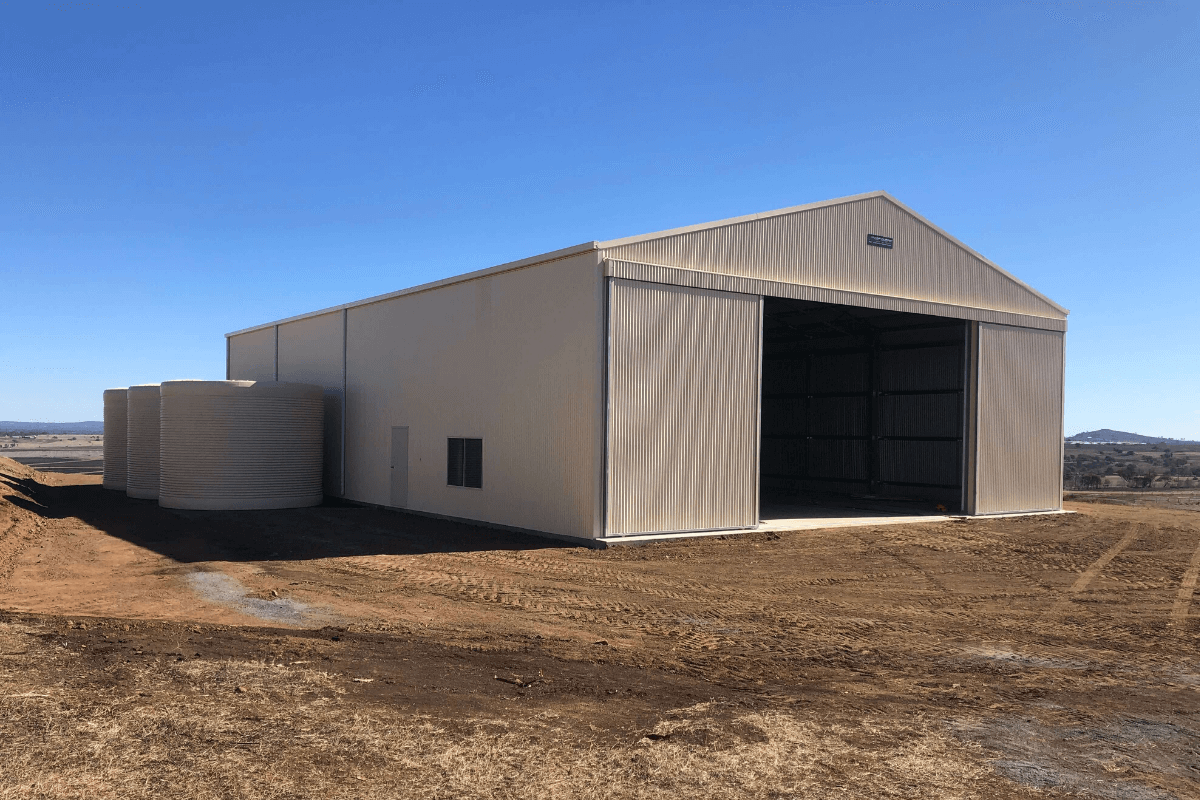 Farm machinery shed with sliding doors