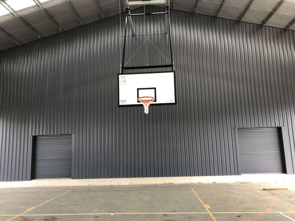 Inside view of cyclone rated shed with basketball hoop in Chelona