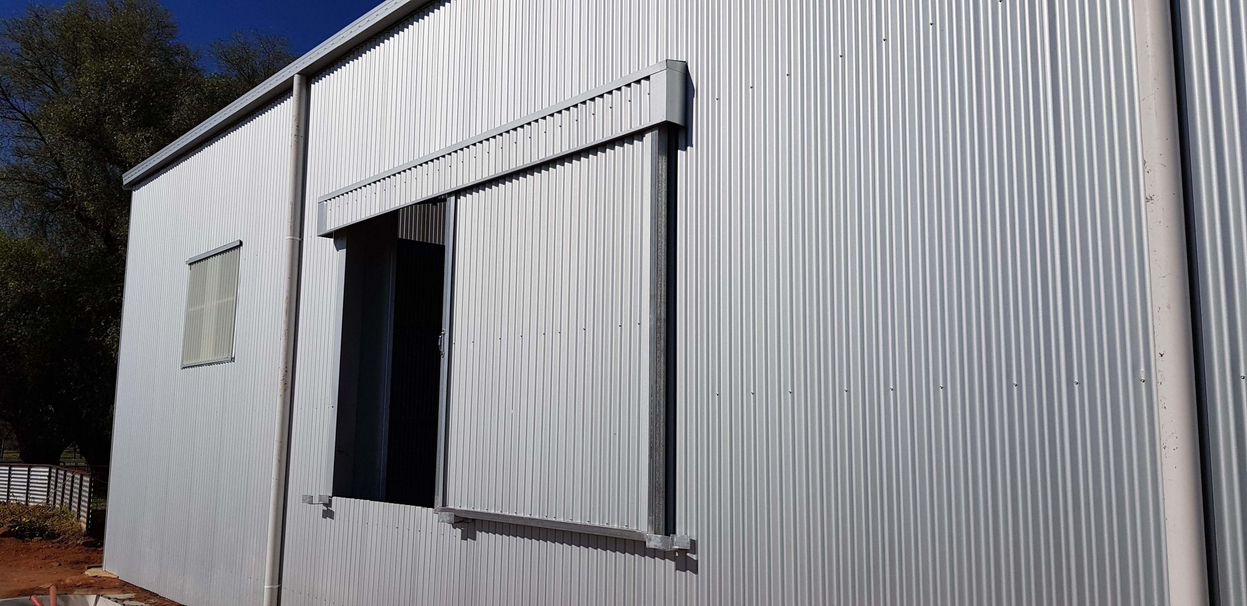 Shearing shed with sliding windows