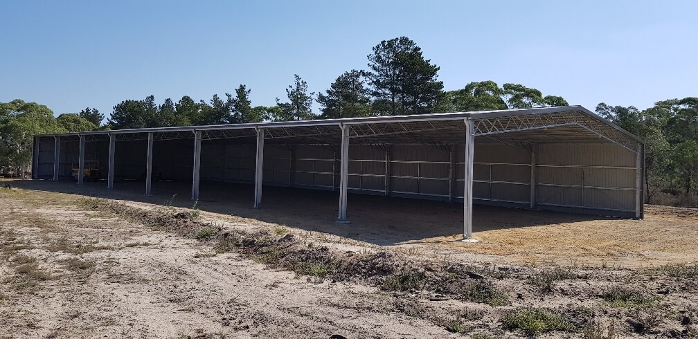Covered dressage arena with eight bays